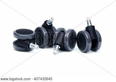 Four Furniture Castor Wheels For Office Chair Isolated On White Background.