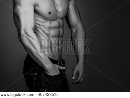 Athletic Man On Black Background. Sport And Workout. Man With Muscular Body And Torso. Coach Sportsm