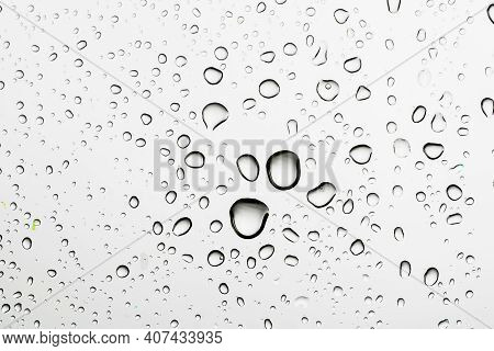 Rain Drops On Window Glasses Surface Natural Pattern Of Raindrops. Natural Pattern Of Raindrops On W
