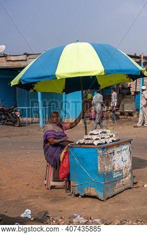 Kolhari, Karnataka, India - November 8, 2013: Roadside Booth Where Female Vendor Sells Home-made Sma