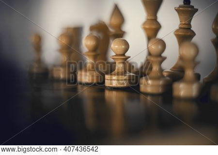 White's Pieces On The Chessboard. Wooden Chess Pieces On The Chessboard. Intellectual Game -chess. C