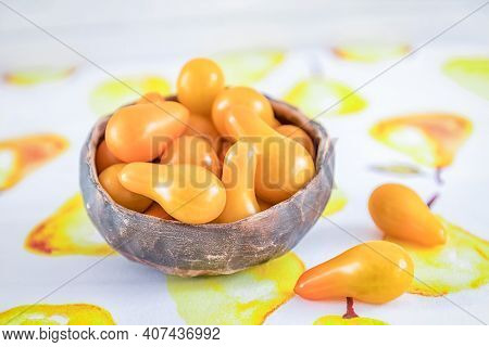 Brown Ceramic Bowl With Orange Pear Heirloom Tomatoes On Light Background