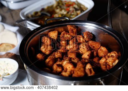 Plate Of Dore Chicken Cut Into Cubes And Served In Pan