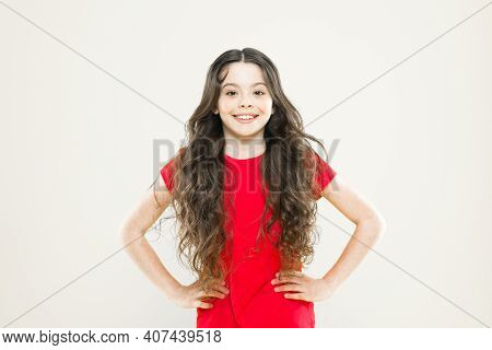 A Perfect Hairstyle. Little Kid With Cute Smile And Fashion Hairstyle. Happy Child With Flowing Hair