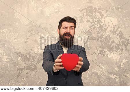 Feast Of Saint Valentine. Generous Man. Handsome Confident Man Hold Red Heart. Businessman Formal Ou