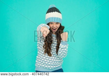 Aggressive Child Warming Up. Teenager In Knitted Hat And Sweater. Childhood Activity. Keep Warm And