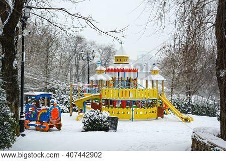 Children's Playground In Istanbul Park In Odessa, Ukraine. Winter Day In Odessa. Snowy, Cold Weather
