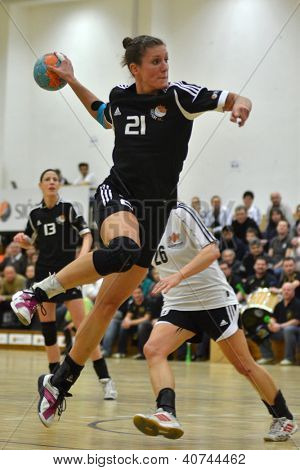 SIOFOK, HUNGARY - JANUARY 5: Csilla Nemeth (in black) in action at a Hungarian National Championship handball match Siofok KC (black) vs. Budapest SE (white) January 5, 2013 in Siofok, Hungary.