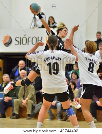 SIOFOK, HUNGARY - JANUARY 5: Ildiko Erdosi (in black) in action at a Hungarian National Championship handball match Siofok KC (black) vs. Budapest SE (white) January 5, 2013 in Siofok, Hungary.
