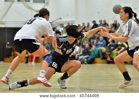 SIOFOK, HUNGARY - JANUARY 5: Nikolett Varga (black 66) in action at a Hungarian National Championship handball match Siofok KC (black) vs. Budapest SE (white) January 5, 2013 in Siofok, Hungary.