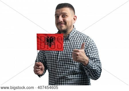White Guy Holding A Flag Of Albania And Shows The Class By Hand Isolated On A White Background. Like
