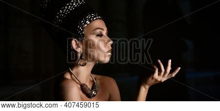 Woman Queen Cleopatra Art Photo, Creative Makeup Black Hair Braids And Carnival Ethnic Costume On Bl