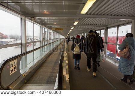 Helsinki, Finland - January 17, 2020: Passengers Leaving The Ferry In The Port Of Helsinki