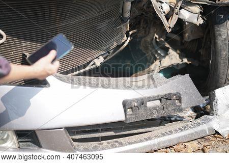 Hand Take Photo Of Crashed Damaged Broken Car. Automobile Crash Accident