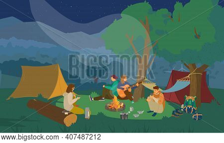 Night Campsite With Group Of Friends Sitting Around Campfire And Playing The Guitar. Hiking Equipmen