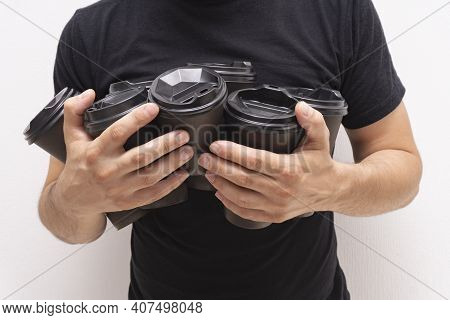Caucasian Mans Hands With Takeaway Cups Of Coffee In Black Paper Cups With Black Lids, No Face, Only
