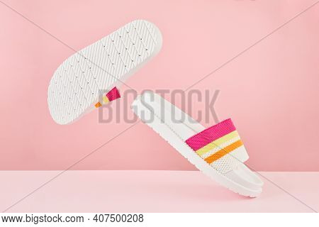 Pair Of Colorful Multicolored Rainbow Flip Flops Or Sandals On Pastel Background. Beach Holidays And