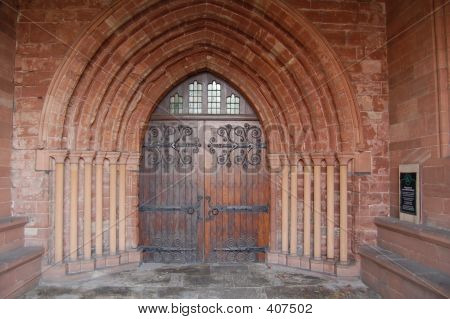 Ancient Church Door With Sandstone Arch