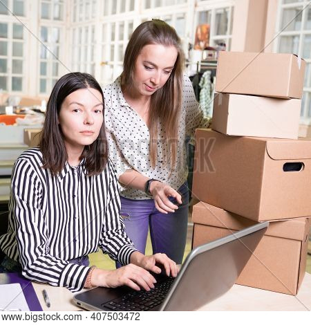 Small Business, Local Production. Two Young Female Colleagues Work In Their Atelier. Entrepreneur An