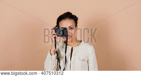 Attractive African American Black Female, Using A Slr Digital Camera Taking Photographs In Studio.