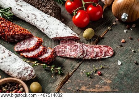 Spanish Tapas Sliced Sausages Salami, Fuet And Chorizo On A Wooden Background. Traditional Spanish S