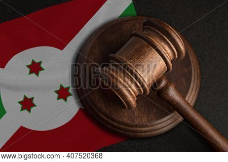 Judge Gavel And Flag Of Burundi. Law And Justice In Burundi. Violation Of Rights And Freedoms.