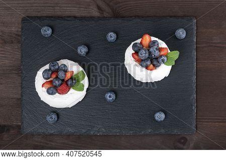 Cake Anna Pavlova. Airy Meringue Garnished With Fresh Strawberries And Blueberries