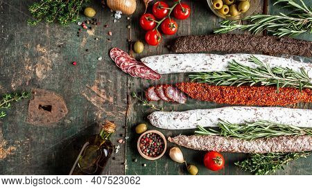 Spanish Tapas Sliced Sausages Salami, Fuet And Chorizo On A Wooden Background. Long Banner Format, T