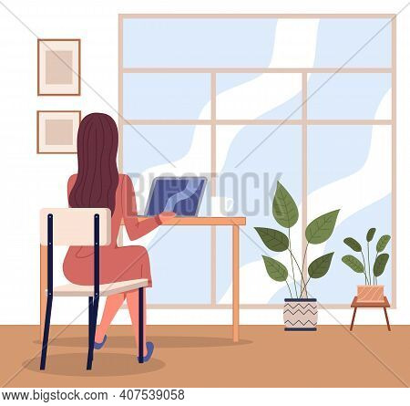 Office Woman At A Desk With A Laptop Back View. Business Woman Or A Clerk Working At Her Office Tabl