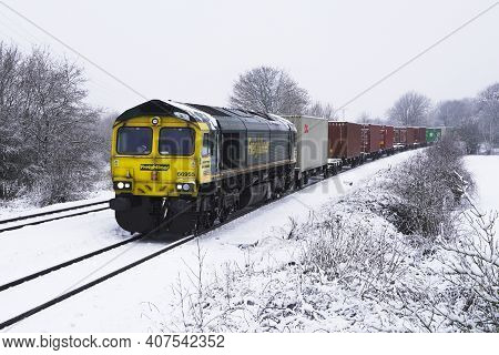 Doncaster, February 2, 2021.  A Freightliner Intermodal Freight Train Carrying Import And Export Shi