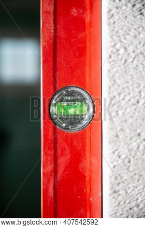 A Red Spirit Level In A Vertical Position.