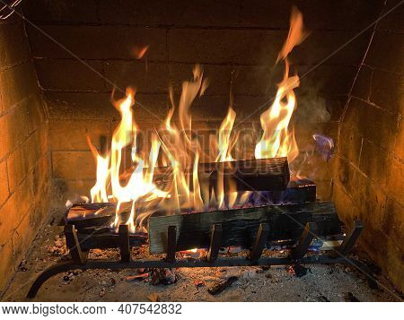 Closeup Of Firewood Burning In Fire. Fireplace In The House. Fire In Fireplace, Firewood Burns In A