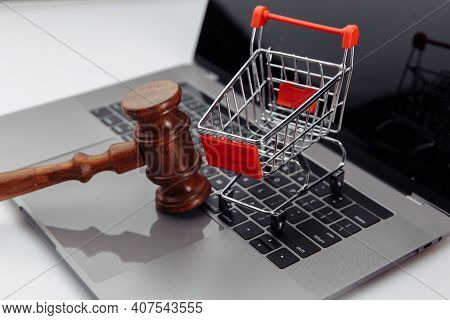 Laptop Keyboard, Shopping Trolley And Auction Hammer On Table, Online Auction Concept