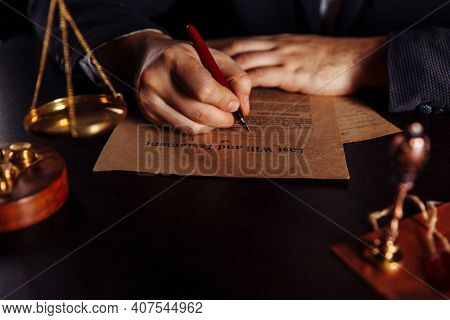 Notarys Public Pen And Stamp On Testament And Last Will. Person In Office Signing Documents
