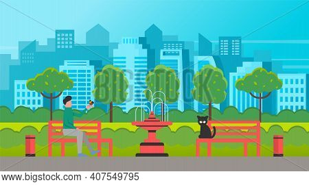 Man Sitting On The Park Bench And Holding A Small Bird In His Hand A Sad Black Cat Sits Nearby. Male