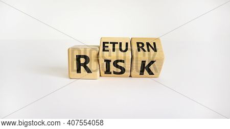 Risk Or Return Symbol. Turned Wooden Cubes And Changed The Word 'risk' To 'return'. Beautiful White