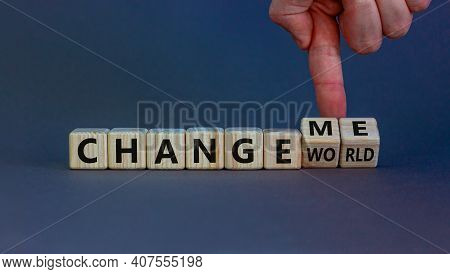 Change World Or Me Symbol. Businessman Turns Wooden Cubes And Changes Words 'change World' To 'chang