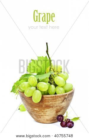 Fresh grape in bowl isolated on white (with easy removable text)