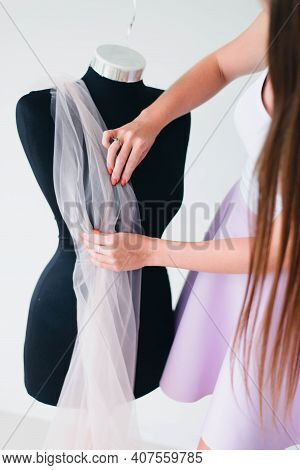A Beautiful Woman-fashion Designer, Designer, Straightening Fabrics On A Tailored Mannequin. The Wor