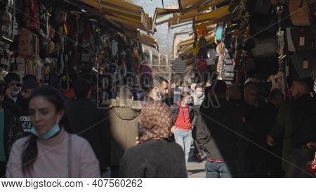 Turkey, Istanbul-december, 2020: Man In Bazaar On Background Crowds Of People. Action. Man Stands Am