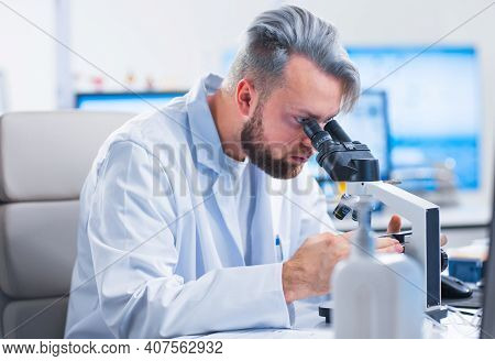 Professional Scientist Is Working On A Vaccine In A Modern Scientific Research Laboratory. Genetic E