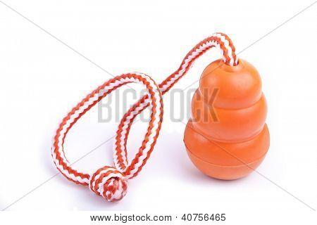 An orange tug type rubber dog toy.
