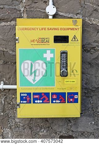 Weston-super-mare, Uk - February 8, 2021: An Emergency Defibrillator Available For Public Use Outsid