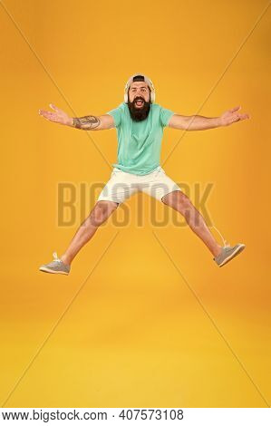 Join Party. Man Listen Music Wireless Headphones In Motion. Bearded Guy Enjoy Music. Hipster Dancing