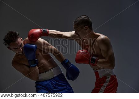 Jab Of Professional Fighter, Fighting Guys In Boxing Gloves During Mixed Fight Sparring, Martial Art