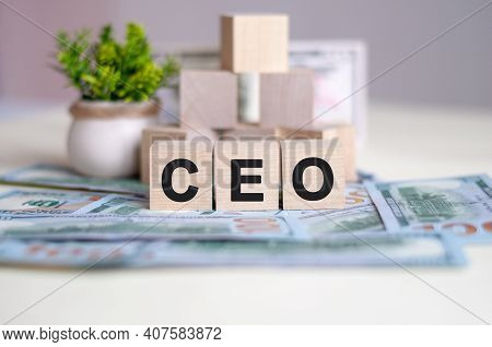 Dollars Banknote With Calculator And Word Ceo. Banknotes And Wooden Cubes With Letters. Ceo Concept