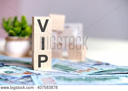 Dollars Banknote With Calculator And Word Vip. Banknotes And Wooden Cubes With Letters Vip. Concept
