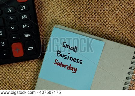 Small Business Saturday Write On Sticky Notes Isolated On Wooden Table.