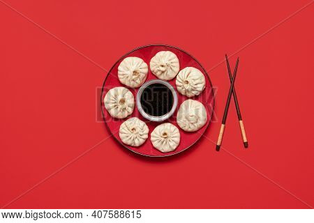 Bao Dumplings On Red Plate With Chinese Sauce, Isolated On A Red Background. Steamed Pork Baozi, Hom