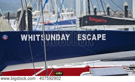 Airlie Beach, Queensland, Australia - February 2021: Whitsunday Escape Vessel Moored In The Marina -